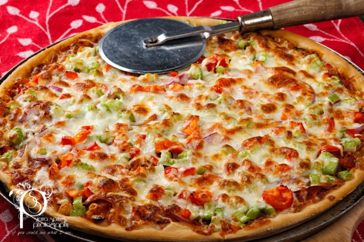 Pizza with Peppers, Celery, Onions, sausage, Pepperoni