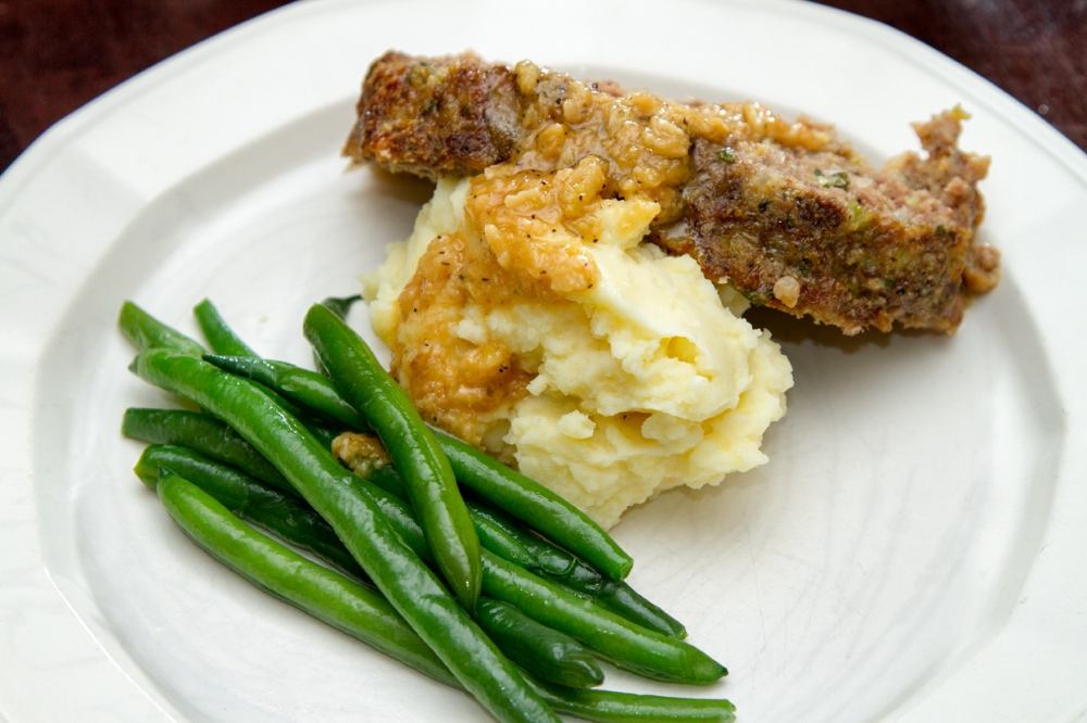 Meatloaf with Mashed Potatoes and Gravy and buttered Green Beans