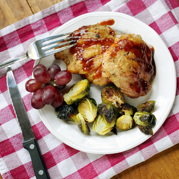 Barbecued chicken with roasted Brussels Sprouts and grapes.  Simple and tasty