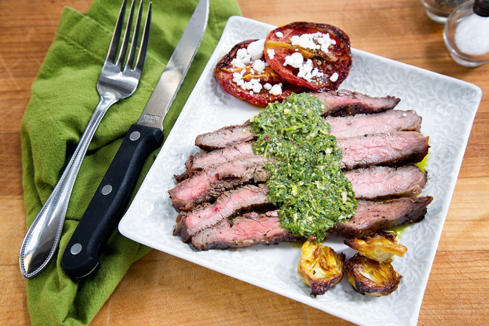 Flank Steak with Chimichurri sauce, roasted artichokes and roasted tomatoes with goat cheese