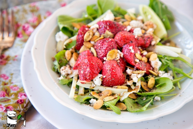 Beautiful marinated strawberries are the star in this salad.