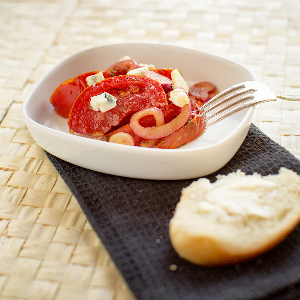 Tomatoes with marinated red onions and blue cheese.