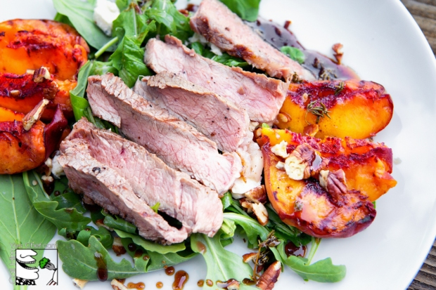 Sliced ribeye with grilled peach salad is the perfect end of summer meal.