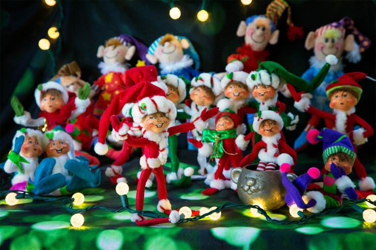 Elves happily sing Christmas Carols