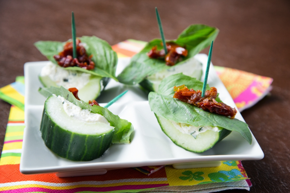 Boursin Stuffed Cucumbers with basil leaf and sun dried tomatoes.