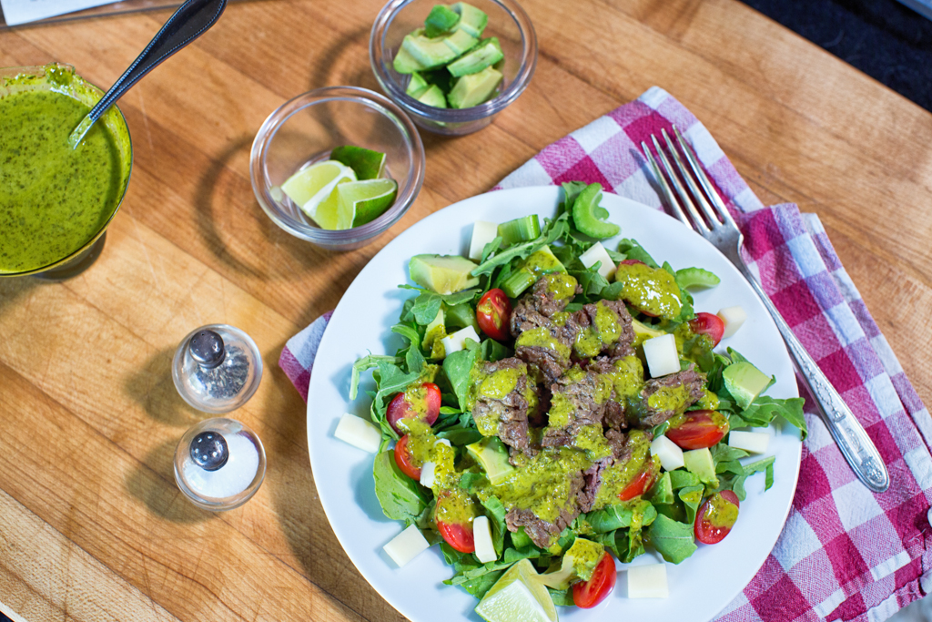 Marinated grilled skirt steak salad with cilantro-lime dressing