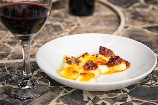 Bread Cheese with toppings and red wine