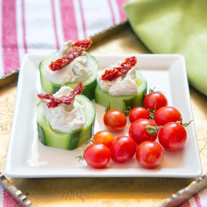 Individual appetizer plate with Blue Cheese Stuffed Cukes and fresh cherry tomatoes