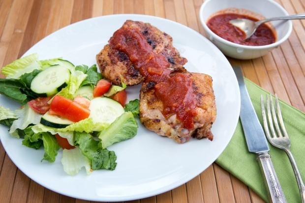 Grilled Chicken Thighs with homemade barbecue sauce and a green salad