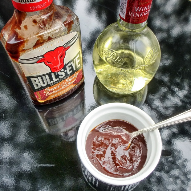 Mix a little vinegar into a sweet barbecue sauce