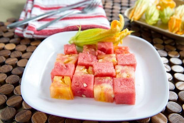 cubed up watermelon and yellow tomato