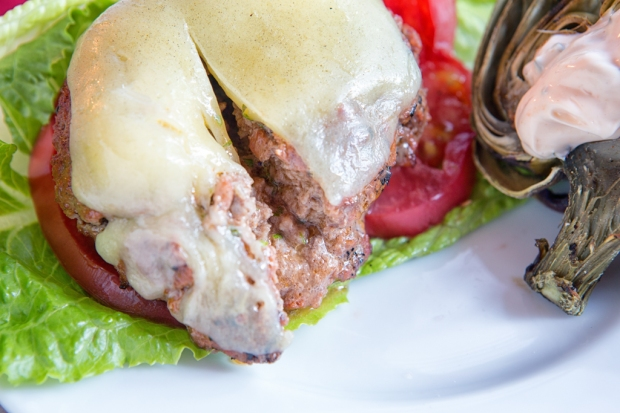 Butter melts into burger leaving herbs inside for a juicy and flavorful burger