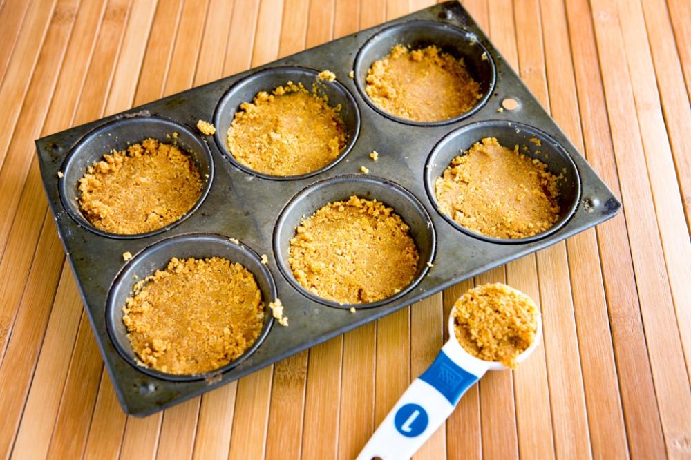 divide graham cracker mixture amongst cups, saving 1 tbsp