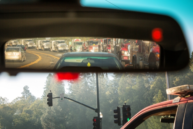 Line up of Fire fighters heading out to the fire in the morning